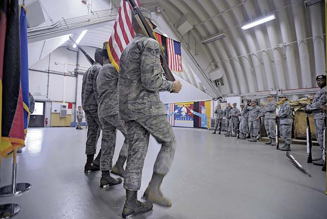 U.S. Air Force Honor Guard members demonstrate color guard movements to members of the Ramstein Honor Guard March 15 on Ramstein.