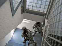 Photo by Senior Airman Damon Kasberg Staff Sgt. Steffan Roverud and Senior Airman Eric Beougher, 569th U.S. Forces Police Squadron patrolmen, clear a stairwell during an active-shooter training May 5 on Vogelweh. During the training, the Airmen were required to move through a building in a two-man team to locate the simulated active shooter.