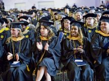 Photos by Katherin Stahl University of Maryland University College Europe graduates eagerly wait to receive their degrees as they reach a momentous milestone in their educational careers April 30 at the Gartenschau in Kaiserslautern.
