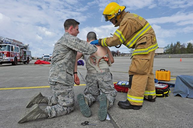 First responders assist a simulated missile-attack casualty during the Wing Thunder inspection April 26 on Ramstein. The first responders arrived on scene first to ensure the scene was safe and all victims were helped in a timely matter.
