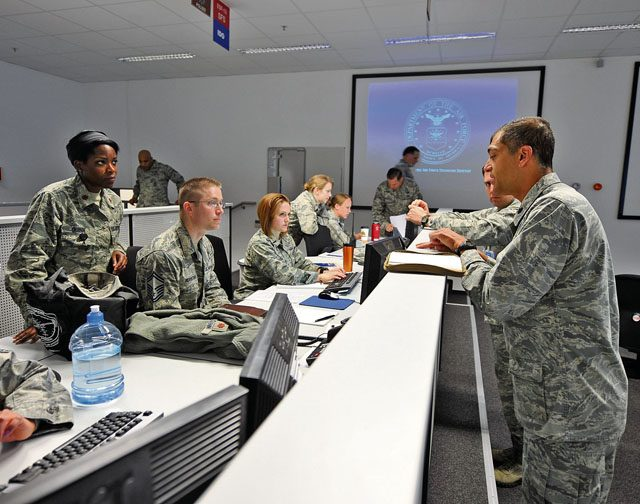 Lt. Col. Paul Silas, Ramstein's Emergency Operations Center director, briefs EOC personnel on procedures and checklists during the Wing Thunder inspection April 25 on Ramstein. The EOC director acts as a liaison between the on-scene and installation commanders during exercise and real-world scenarios.