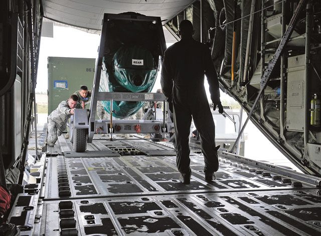 Staff Sgt. Josh Wade, 86th Aircraft Maintenance Squadron crew chief, helps loadmasters from the 37th Airlift Squadron load cargo onto a C-130J Super Hercules during Wing Thunder April 22 on Ramstein. Aircraft maintainers and loadmasters work hand in hand to ensure all aircraft cargo and passengers are securely fastened prior to takeoff.