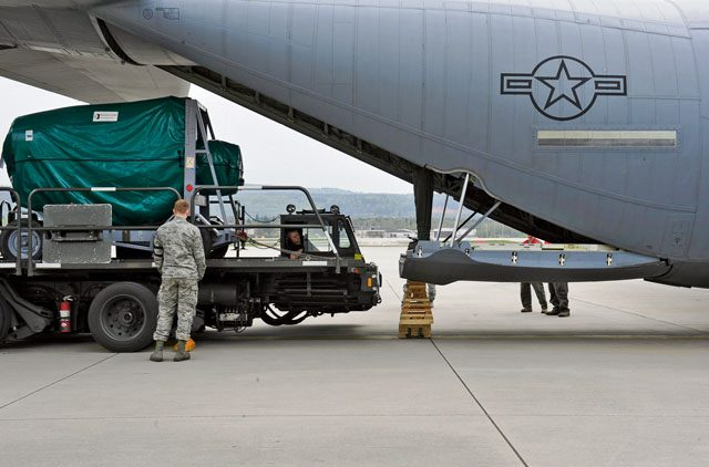 An Airman from the 86th Aircraft Maintenance Squadron stands by to assist in loading cargo onto a C-130J Super Hercules during Wing Thunder April 22 on Ramstein. Team Ramstein conducted the inspection, Wing Thunder, to exercise the 86th Airlift Wing's readiness and operational capabilities April 17 through 27.