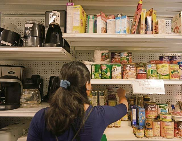 Photo by Airman 1st Class Joshua Magbanua A military spouse picks donated canned goods at the & Airmanu0027s Attic gives back to community - Kaiserslautern American ...