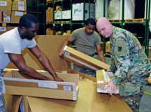 Soldiers from the 21st Theater Sustainment Command help unload a shipment of weapons July 27 at the Kaiserslautern Army Depot. The new weapons consisted mainly of new M4 rifles.