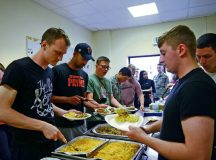 Airmen partake in a meal together July 15 on Ramstein. The free weekly dinner for Airmen E-4 and below is part of the ministry of Club 7.