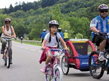 Families enjoy the car-free adventure day scheduled from 10 a.m. to 7 p.m. Sunday.