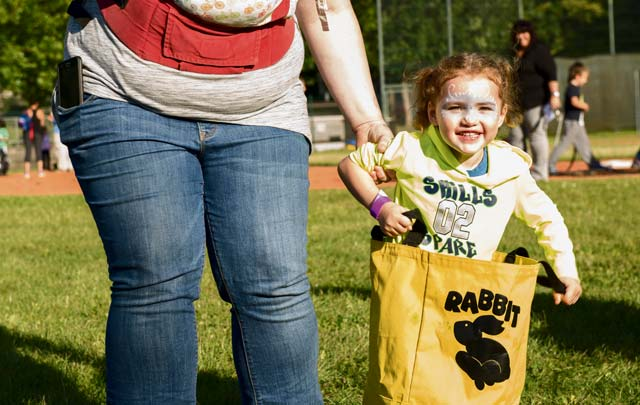 A child participates in a potato sack race during the Ramstein and Vogelweh Community Center's Olympic Family Night Aug. 22, 2016, at Ramstein Air Base. The community centers hosted the event to help boost morale within the Kaiserslautern Military Community.