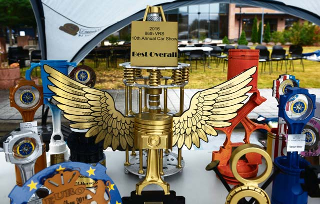 Trophies made from car parts rest on a table during a car show Aug. 20, 2016, at Ramstein Air Base. Winners received the trophies based on the appearance, physical condition, additional mechanical work on the engine and accessories added to their vehicles.