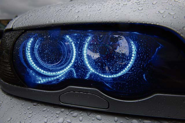 A 1999 BMW E46 328Ci headlight shines blue light during the 86th Vehicle Readiness Squadron Auto Show Aug. 20, 2016, at Ramstein Air Base. Approximately 180 participants from around the Kaiserslautern Military Community and Europe attended the 10th annual auto show.