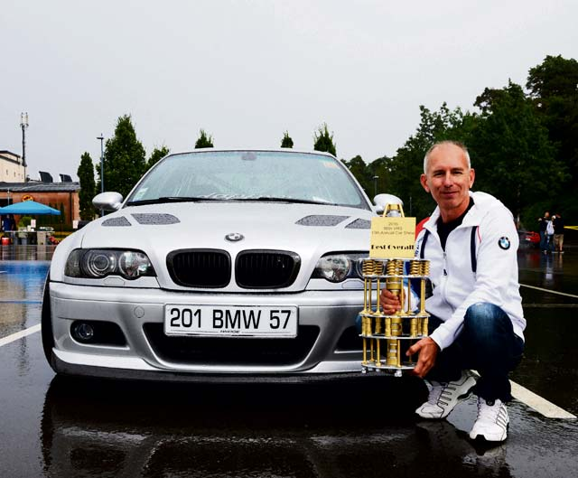 Patrick Sliwinski, a participant from France, poses next to his 1999 BMW E46 328Ci Aug. 20, 2016, at Ramstein Air Base. Sliwinski won the Best Overall award at the 10th annual 86th Vehicle Readiness Squadron Auto Show.