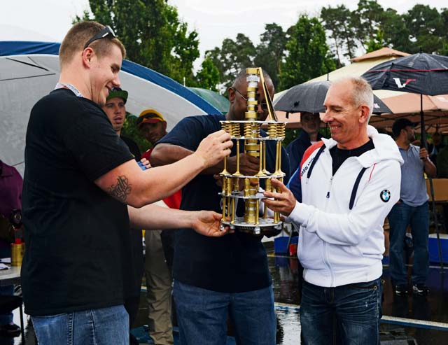 Patrick Sliwinski, right, a participant from France, receives the Best Overall award Aug. 20, 2016, at Ramstein Air Base. Sliwinski showcased his 1999 BMW E46 328Ci at the 10th annual 86th VRS Auto Show.