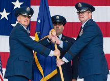 Photo by Airman 1st Class Lane Plummer Lt. Gen. Timothy M. Ray, 3rd Air Force commander (left), passes the guidon to Brig. Gen. Richard G. Moore during the 86th Airlift Wing change of command ceremony as Chief Master Sgt. Aaron D. Bennett, new 86 AW command chief, looks on Aug. 17 on Ramstein. The passing of a wing's guidon symbolizes a transfer of command.