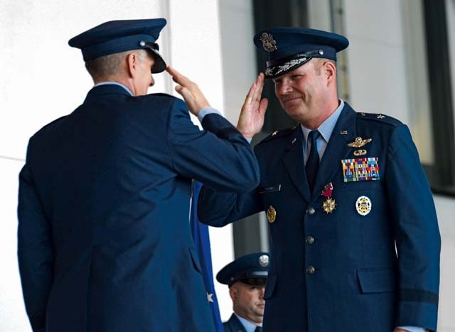 Photo by Airman 1st Class Joshua Magbanua Brig. Gen. Jon T. Thomas (right) salutes Lt. Gen. Timothy M. Ray, 3rd Air Force commander, after being awarded the Legion of Merit medal in recognition of his service as the 86th Airlift Wing commander Aug. 17 on Ramstein. Thomas is slated to become the director, Strategic Plans, Requirements and Programs, Headquarters Air Mobility Command, Scott Air Force Base, Illinois.