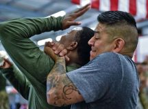 Master Sgt. Anthony Sanchez, 569th U.S. Forces Police Squadron NCO in charge of training, holds Staff Sgt. LaDonna Winston, 435th Security Forces Squadron ground regional training center instructor, in a tight grip Aug. 4 on Ramstein. During the course, students practiced different techniques to be better prepared for an attack.