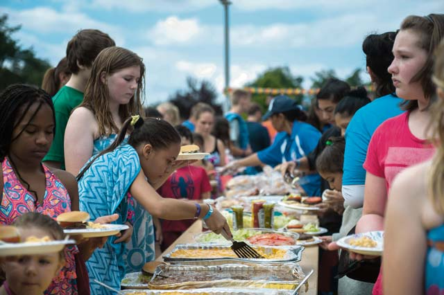 Photo by Airman 1st Class Lane T. Plummer  Families get food during a party for family members of deployed Airmen Aug. 12, 2016, at Ramstein Air Base. The event was held for family members of deployed Airmen around the Kaiserslautern Military Community to bring families closer through a variety of food and games.
