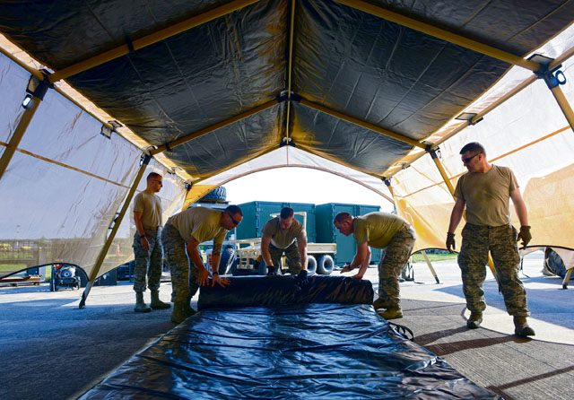 Airmen from the 435th Contingency Response Group take down a Tent Model 60 tent during training July 18 on Ramstein. The Airmen repeated the process of assembling and disassembling the tent several times in order to familiarize themselves with the new system.