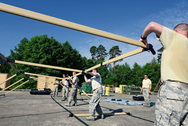 Airmen from the 435th Contingency Response Group assemble the frame of a Tent Model 60 tent July 18 on Ramstein. The newly acquired tents are designed to be more durable than the tent models the 435 CRG previously used.