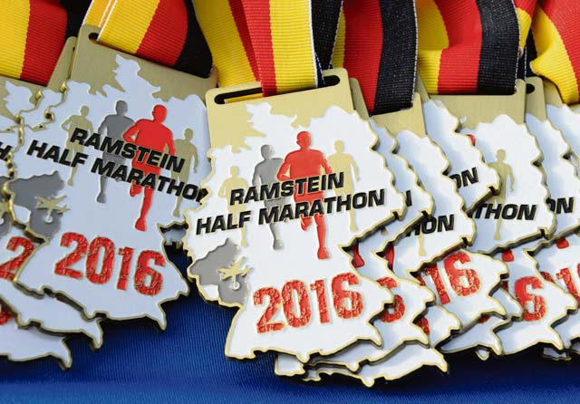 Participation medals lay on a table for runners to receive after the Ramstein Half Marathon August 20, 2016, at Ramstein Air Base. Runners also received a t-shirt and a sling bag after they crossed the finish line.
