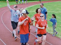 Runners celebrate finishing their last lap during the Viking Challenge July 23 on Pulaski Barracks. After the marathon ended, awards and appreciation were given out.