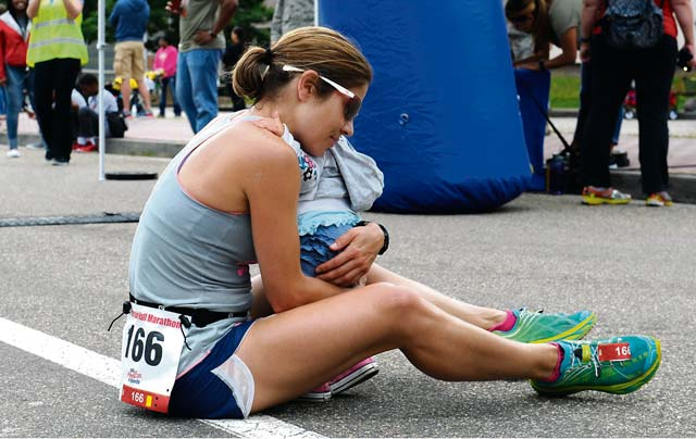 Dreama Walton, Landstuhl Regional Medical Center Information Management Division systems administrator, hugs her daughter after finishing the Ramstein Half Marathon August 20, 2016, at Ramstein Air Base. The first person to finish the race at 1 hour and 13 minutes was U.S. Army Pfc. Elias Chesire, 214th Aviation Regiment Blackhawk mechanic. Walton was the first female to cross the finish line at 1 hour and 31 minutes.