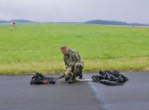 A German parachutist packs his bag after jumping from a U.S. Army CH-47 Chinook during International Jump Week July 27 on the drop zone in Bitburg, Germany. Over 150 parachutists from the U.S. and seven other countries participated in the weeklong annual event designed to build partnership capacity by conducting airborne operations.