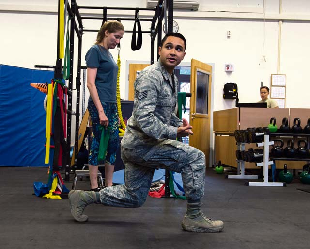 Staff Sgt. Mario Jimenez, 86th Medical Operations Squadron physical therapy technician, demonstrates proper lunge form during a knee rehabilitation class at Ramstein Air Base, Aug. 2, 2016. Due to manning, the knee and back rehabilitation classes were created to provide instruction to numerous patients with similar injuries and exercise routines.