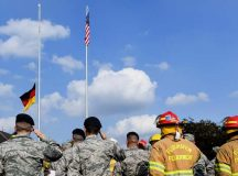 Photos by Senior Airman Tryphena Mayhugh Airmen from the 86th Airlift Wing salute during the lowering of the German flag Sept. 9 on Ramstein. The Airmen were participating in a 9/11 memorial retreat ceremony to honor the 2,977 lives lost during the attacks.