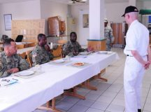 Photos by Pfc. Dashaad Boyd Sgt. Aaron Warren, 317th Mission Support Command cook, presents the dish he created for the Culinary Warrior of the Year cook-off competition Sep. 7 on Kleber Kaserne.