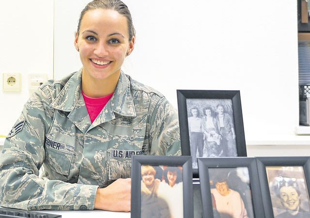 Senior Airman Jordan Hebner, 86th Dental Squadron dental technician, poses with portraits of her grandmother and great-aunts Oct. 14 on Ramstein. Hebner's grandmother and great-aunts have been affected by breast cancer, which is the second most common cancer for women in the United States.