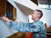 Tech. Sgt. Jere Ross, 86th Airlift Wing chaplain corps NCO in charge of plans and programs, sets up the Ramstein North Chapel for a religious service Sept. 21 on Ramstein. The Ramstein chapel community serves the spiritual needs of Airmen regardless of religion or spiritual beliefs.