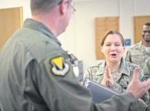 Senior Master Sgt. Susan Hale, 86th Medical Squadron command support section operations superintendent, reacts ecstatically after being notified of her promotion to chief master sergeant Dec. 8 at Landstuhl Regional Medical Center. By congressional mandate, only one percent of the Air Force enlisted corps may hold the rank of chief master sergeant.