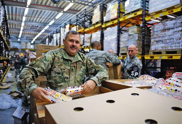 Sgt. 1st Class Jonathan Lukacsko, U.S. Army Public Health Activity-Rheinland Pfalz operations NCO, volunteers at the Thanks for Thanksgiving event Nov. 19 on Vogelweh. This year is the first time in 17 years the Army and the Air Force have collaborated for Thanks for Thanksgiving, creating more than 660 meals for military families.