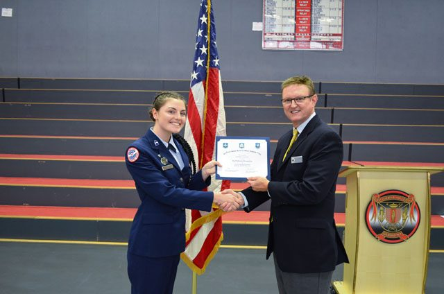 Cadet Maj. Justine Beard, 12th-grader at Kaiserslautern High School, receives the Outstanding Performer award from Wayne Barron, inspector, during the Headquarters Air Force Junior ROTC evaluation Oct. 25 at KHS on Vogelweh.