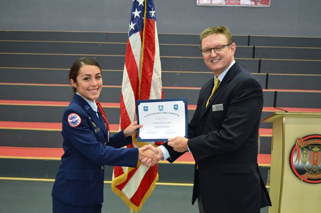 Cadet Maj. Alexiis Figueroa, 12th-grader at Kaiserslautern High School, receives the Outstanding Performer award from Wayne Barron, inspector, during the Headquarters Air Force Junior ROTC evaluation Oct. 25 at KHS on Vogelweh.
