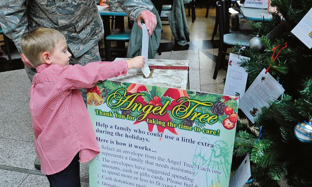 Wyatt Jacobs, son of Chief Master Sgt. Taylor Jacobs, 21st Operational Weather Squadron superintendent, places an Angel Tree donation into a box Nov. 8 on Ramstein. The Angel Tree program provides assistance to see Airmen through unforeseen financial difficulties.