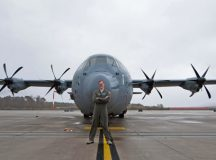 Airman 1st Class Patrick Stone, 37th Airlift Squadron loadmaster, poses in front of a C-130J Super Hercules Nov. 17 on Ramstein. Stone, along with wingman Staff Sgt. James Gaston, 37 AS loadmaster, worked together to create a new repair program within their unit, which salvages usable parts from nonfunctional headsets to create complete units. In the first iteration of their program, Gaston and Stone were able to assemble nine fully functional headsets from individual components, thus reducing the number of new headsets needing to be purchased. Together, they saved the Air Force $8,100.