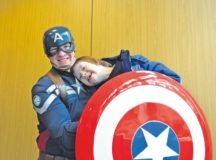 Captain America poses for a picture with a student during the 2016 Winter Special Olympics Dec. 2 on Vogelweh. Activities from the event included bowling and arts and crafts, with visits from Captain America and Santa Claus.