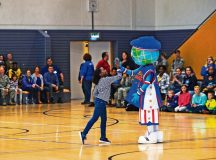 Globie, Harlem Globetrotters mascot, gives an audience member a high-five during a performance Nov. 10 on Ramstein. The 86th Force Support Squadron, Armed Forces Entertainment and Navy Entertainment brought the Harlem Globetrotters to Ramstein in order to boost the morale of Department of Defense members and their families. The basketball exhibition team combines elements of sports, theater and comedy to produce entertaining shows for its audiences.