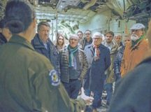 Senior Airman Tristan Geray, 37th Airlift Squadron loadmaster, explains different aspects of her job during a base tour Dec. 2 on Ramstein. A group of local leaders from the Weilerbach Union Community received a tour of Ramstein and observed the inside of a C-130J Super Hercules.