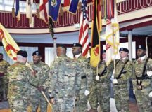 Col. Keith E. Igyarto, U.S. Army Garrison Rheinland-Pfalz commander, passes the garrison colors to incoming Command Sgt. Maj. Ulysses D. Rayford during the USAG Rheinland-Pfalz change of responsibility ceremony Dec. 16 at Armstrong's Club on Vogelweh. Rayford assumed responsibility of the garrison from Command Sgt. Maj. Edward J. Williams III.