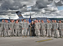 "Courtesy photo Gertrude ""Gertie"" Grosskopf, 721st Aerial Port Squadron fleet service supervisor and air transportable galley and lavatory manager, takes a photo with members of the 721 APS on the flightline of Ramstein. Gertie is retiring after serving the Air Force for more than 39 years. During her time, she became known as the go-to person for the ATGLs not only in the squadron but for all of Air Mobility Command."