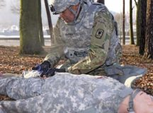 Spc. Baholo Maphiri from Headquarters and Headquarters Company, 457th Civil Affairs Battalion, 7th Mission Support Command, treats a simulated casualty during the 7th MSC enlisted Best Warrior competition Jan. 23.