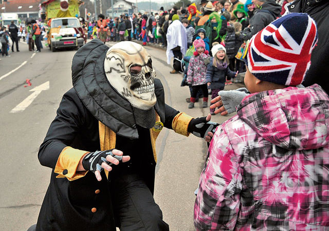 U.S. Air Force photo An individual in costume scares the spectators along the route of last year's Fasching parade in Ramstein-Miesenbach. This year's parade starts at 2 p.m. Tuesday.