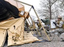 Airmen assigned to the 435th Contingency Response Group work together to build a tent during exercise Austere Forge Feb. 1 on Ramstein. During the exercise, the Airmen planned what equipment would be used and who would be going, readied the equipment and personnel, processed through the 86th Logistic Readiness Squadron's installation deployment readiness cell and set up tents and equipment in a simulated deployed location. The 435 CRG participated in the exercise to practice their capability to deploy within 72 hours.