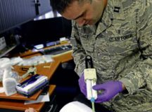 Capt. Christopher Tracy, 86th Dental Squadron dentist, applies molding material to the ear of an Air Force Office of Special Investigations agent Jan. 6 at an OSI office on Ramstein. Each mold took 10 to 15 minutes to become firm enough to remove.