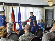 Master Sgt. Henry Lopez, U.S. Air Forces in Europe readiness and plans manager, and Senior Airman Zachary Abraham, 435th Security Forces Squadron commander's support staff, fold an American flag during a dual retirement ceremony Feb. 24 on Ramstein. John and Colynn Hamilton, USAFE management analyst and human resources specialist, respectively, as well as husband and wife, retired after more than 80 years of combined service.