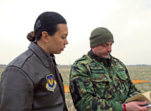 Capt. Mary Bordelon, 37th Airlift Squadron flight commander and Exercise Thracian Spring 17 mission commander talks with Master Sgt. Momchil Kostov, Bulgarian Special Operations 1st Battalion, 68th Brigade special warfare personnel, March 15 at Plovdiv Regional Airport, Bulgaria. Bordelon visited the drop zone team to watch the team execute the first personnel drop for the two-week exercise. The U.S. Air Force's forward presence in Europe allows Airmen to work with our Nato allies and partners, to develop ready air forces capable of maintaining regional security