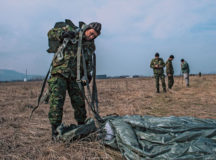 A Bulgarian military paratrooper removes his parachute at the drop zone during Exercise Thracian Spring 17 at Plovdiv Regional Airport, Bulgaria, March 15. Drop zones are thoroughly surveyed in advance and inspected before every drop in order to ensure a safe landing for personnel or cargo. More than 60 Airmen from Ramstein participated in combined air operations with the Bulgarian military to strengthen relationships while building their nations' joint military capabilities.