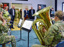 Sembach community leaders listen to a brass quintet rehearse at the U.S. Army Europe Band and Chorus Headquarters. U.S. Army Garrison Rheinland-Pfalz held a community relations tour to acquaint the leaders with local U.S. missions, while strengthening partnerships at Sembach Kaserne March 14.